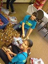 Stuffing goodie bags at convention