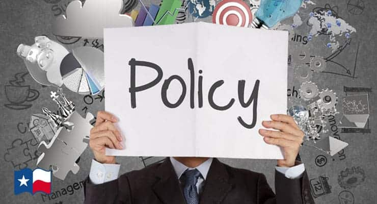 Man Holding a Policy Sign
