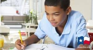 homeschool boy writing an assignment